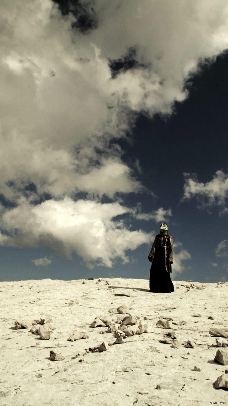 kite headed lady in white noise machine by Mali Weil video still